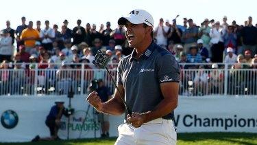 A jubilant Jason Day celebrates his win and his new no.1 ranking.