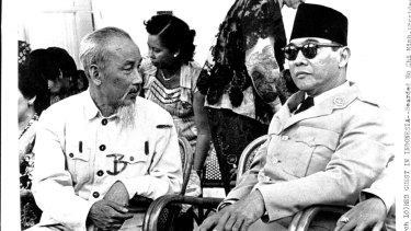Ho Chi Minh President of Communist-ruled North Vietnam chats with Indonesian president Ahmed Sukarno at an outdoor party in Tjipanas during the communist leader's state visit to Indonesia in 1959.
