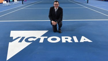 Victorian Premier Daniel Andrews poses with the new Victoria logo.
