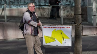 Mick Dempsey takes a novel approach to trying to find a job in Collins Street this week.