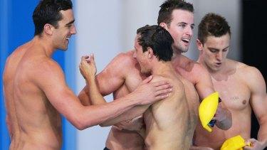 Australia celebrates their bronze medal in the men's 4x100m relay.
