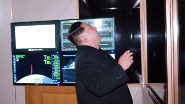 North Korean leader Kim Jong-un appears to watch the launch of a missile on Wednesday.