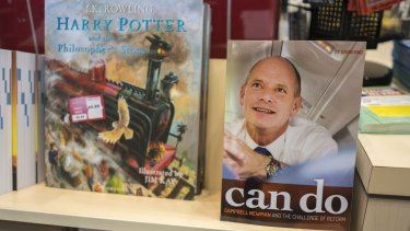 """Campbell Newman's new book """"Can Do: Campbell Newman and the Challenge of Reform"""" at a book store in Brisbane."""