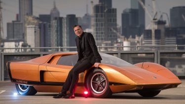 Michael Simcoe, seen here with the 1969 Holden Hurricane, says we'll be seeing driverless cars  within 'a year or so'.