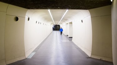 A futuristic tunnel leading to Museum Station in Sydney.