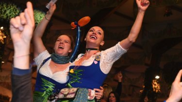 Waitresses celebrate after closing of a tent on the last day of the Oktoberfest beer festival in Munich, southern Germany.