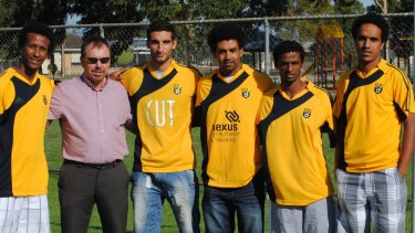 Eritrean soccer players who defected from their homeland, sought asylum in Kenya in 2009 and eventually wound up in Australia, in their new Australian club colours. Left, Samuel Gebrihiwet, fourth from left Ermias Maekele, fifth from left Nevi Gebremeskel and sixth from left, Ambasager Sium.