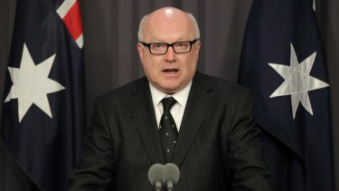 Attorney-General George Brandis's office said an expensive dinner on taxpayers during a visit to London was usual practice.