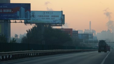 The road to Yanjiao is filled with billboards advertising residential property developments