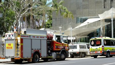 Emergency services are seen attending 1 Eagle Street after the ceiling collapse.
