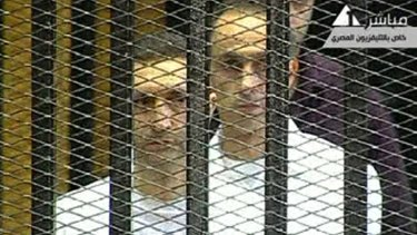 The sons of Hosni Mubarak, Alaa, left, and Gamal, in the defendants' cage in Cairo in 2011.