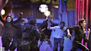 The moment five hostages fled the Lindt cafe in December 2014, where they had been captive.