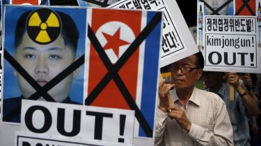 A man from a conservative civic group holds up a banner depicting North Korean leader Kim Jong-un during an anti-North Korean rally in central Seoul, South Korea, on Friday.