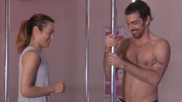 Melissa Singer learning the Chinese pole routine from Mumm marquee artist Mikael Bres.