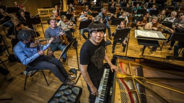 Chinese concert pianist Lang Lang rehearsing with the Queensland Symphony Orchestra.