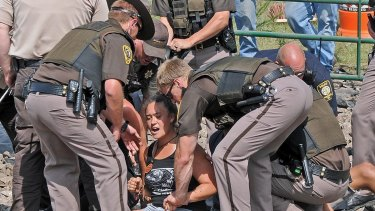 Several people protesting the Dakota Access Pipeline were arrested in August while blocking a road near the site of the pipeline.