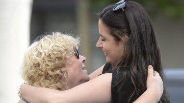 Veronika Taylor, sister of Elvira Buckingham, hugs former Shepparton News reporter Tammy Mills.