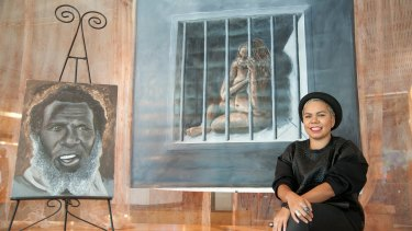 Boneta-Marie Mabo with her previous work of her grandfather Eddie Mabo.
