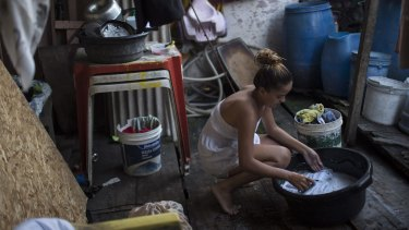 Marilia da Silva, 14, washes her clothes in a slum in Recife, Brazil. The Zika virus, spread by the Aedes aegypti mosquito, thrives in people's homes and can breed in even a bottle cap's-worth of stagnant water.