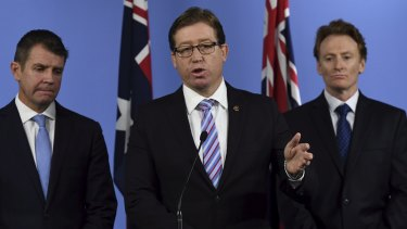 Deputy Premier Troy Grant (centre) during a conference on the report of the Special Commission of Inquiry into the Greyhound Racing Industry.