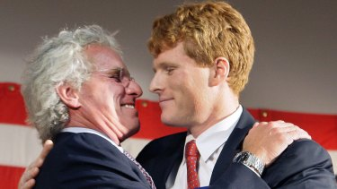 Joseph Kennedy II, left, hugs his son, Joseph Kennedy III after introducing him at campaign rally in 2010.