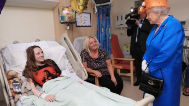 The Queen speaks to Millie Robson, 15, and her mother, Marie, during a visit to the Royal Manchester Children's Hospital.