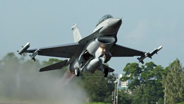 A Taiwan Air Force F-16 fighter jet takes off from a closed section of highway during the annual Han Kuang military exercises in Chiayi, central Taiwan.
