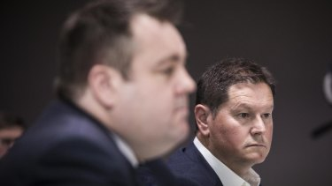 Uber's Brad Kitschke and Airbnb's Sam McDonagh at the Senate inquiry into corporate tax avoidance.