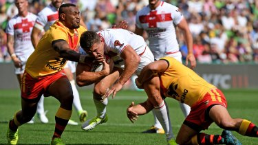 Direct: Sam Burgess makes headway, giving PNG defenders plenty of headaches.
