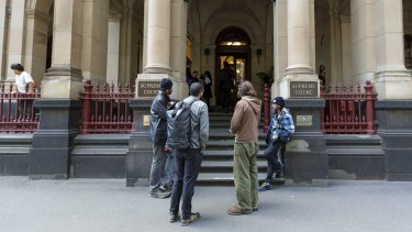 Bendigo Street squatters in front of the Supreme Court on Sunday afternoon.
