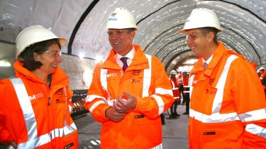 NSW Premier Mike Baird (centre), Treasurer Gladys Berejiklian and Transport and Infrastructure Minister Andrew Constance discuss the Sydney Metro Northwest rail link.