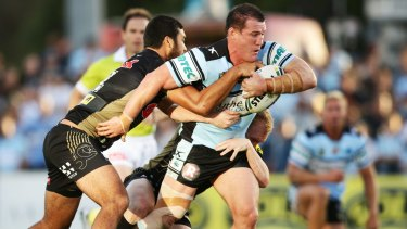 Paul Gallen leads the charge for the Sharks against the Panthers.