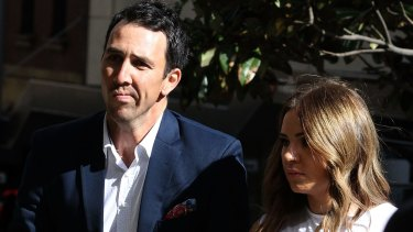 Tough time: Tom Cooper arrives at the inquest into the death of Phillip Hughes.