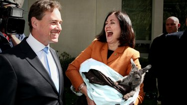 Environment Minister Greg Hunt and Liberal MPs Sarah Henderson meet a wallaroo for Threatened Species Day at Parliament House on Monday.