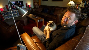 Dr Stephen Fleischfresser and his cat, Max Power, to whom he is hopelessly devoted.