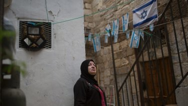 Nawal Eid Hashimeh, a Palestinian woman whose family received eviction orders, outside her house in the Old City in East Jerusalem.