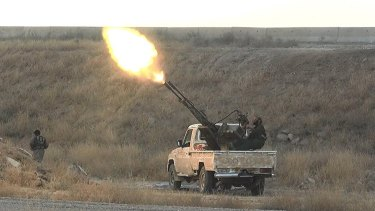 Islamic State fighters fire at Syrian regime planes last year, in an image from a militant website.