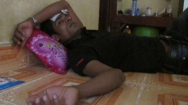 Mohammed Rashid, a refugee from Nauru, lies unwell in a house in a Phnom Penh suburb.