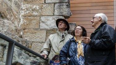 Tour guide Rex Wood shows French tourists Sydney and Monique Birchall around the Mint. The building is Sydney's oldest surviving public building.