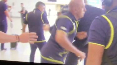 The South African security guard elbowing the journalist in the ribs.