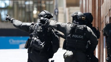 Under pressure: The chain of command and communications between agencies during the Martin Place siege is being scrutinised by a joint review.