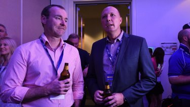 Immigration Minister Peter Dutton is seen at the LNP Election party.