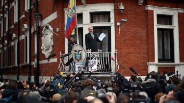 Julian Assange speaks from the balcony of the Ecuadorian embassy in London in February.
