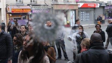 Bullet holes adjacent to the La Belle Equipe cafe in Paris France.