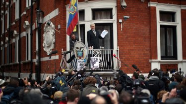 Julian Assange speaks from the balcony of the Ecuadorian embassy late last week.