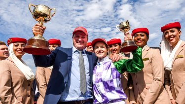 Winners are grinners: Darren Weir and Michelle Payne celebrate their Melbourne Cup win in 2015.