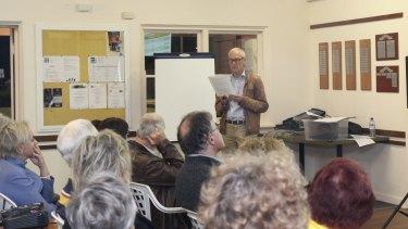 Planning expert Ian Macrae presents research to a public forum raising concerns about DAPs' efficiency.