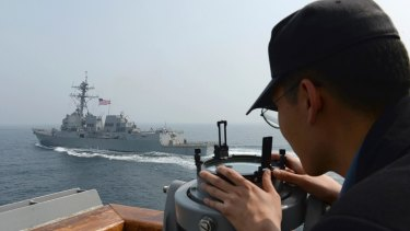 A South Korean navy sailor watches the destroyer USS Wayne E. Meyer during a joint exercises between the United States and South Korea.