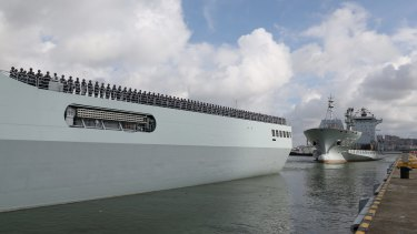 Ships carrying Chinese military personnel depart a port in Zhanjiang, in China's Guangdong Province, bound for the Horn of Africa.