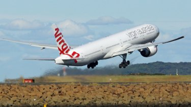 A radio hoaxer told a Virgin pilot to abort a landing.
